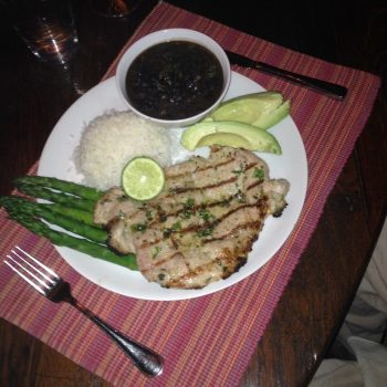 Cuban style chicken paillard with black beans at Casa de los Desperados
