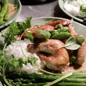 Game hens with thai green curry, white rice and asparagus