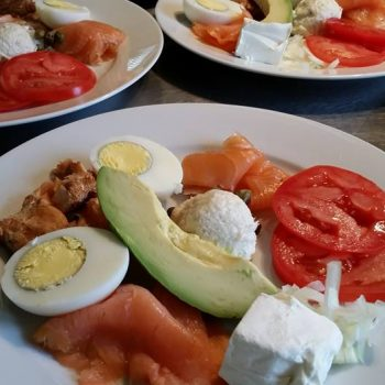 New York style breakfast fish plate: gravlax hickory smoked salmon, cold smoked salmon, whitefish salad, hard boiled eggs, tomato, capers and chopped onion