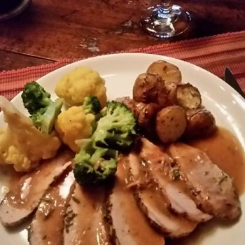 Roast loin of pork with yellow cauliflower broccoli and new potatoes at Casa de los Desperados dinner