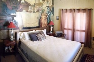 Stay in the Fresco Room at Casa de los Desperados