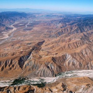 Aerial shot of the fault line oasis and the canyon it formed behind the lodge