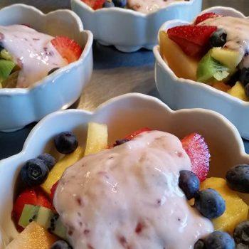 Breakfast starter: pineapple, strawberries, kiwi, cantaloupe, blueberries and yellow plum with homemade strawberry yogurt