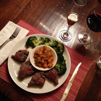 T-bone lamb chops with marinated yellow tomato salad and broccoli